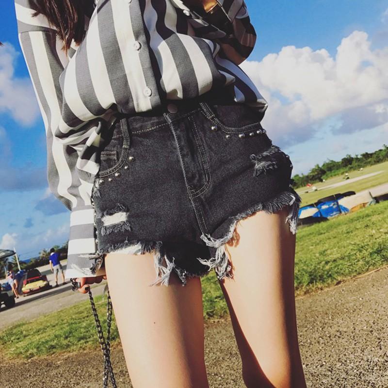【 】實拍 鉚釘刷破毛邊修身牛仔短褲水洗不規則黑色破褲休閒褲熱褲復古小高腰學生百搭顯瘦丹寧