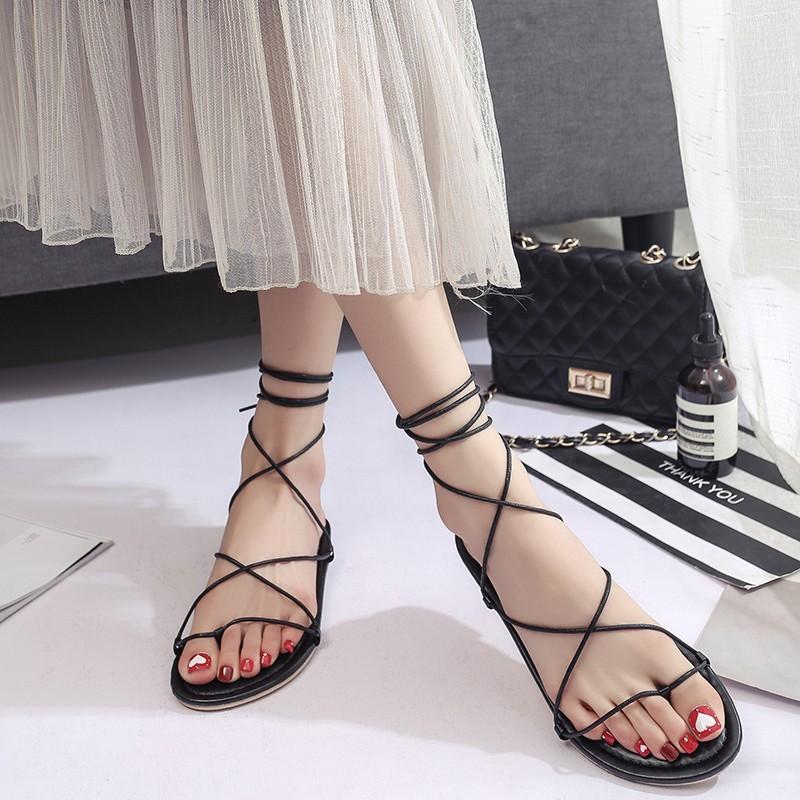 女涼鞋2017  平底平跟女鞋交叉綁帶夾腳趾沙灘綁帶系帶繞腕