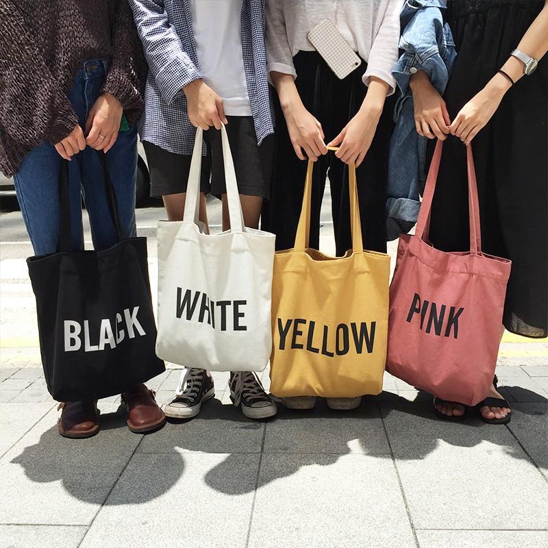 現黑黃✨ 款手提包字母顏色color 簡約街頭帆布包方包英文大包印花 袋托特包書包媽媽包