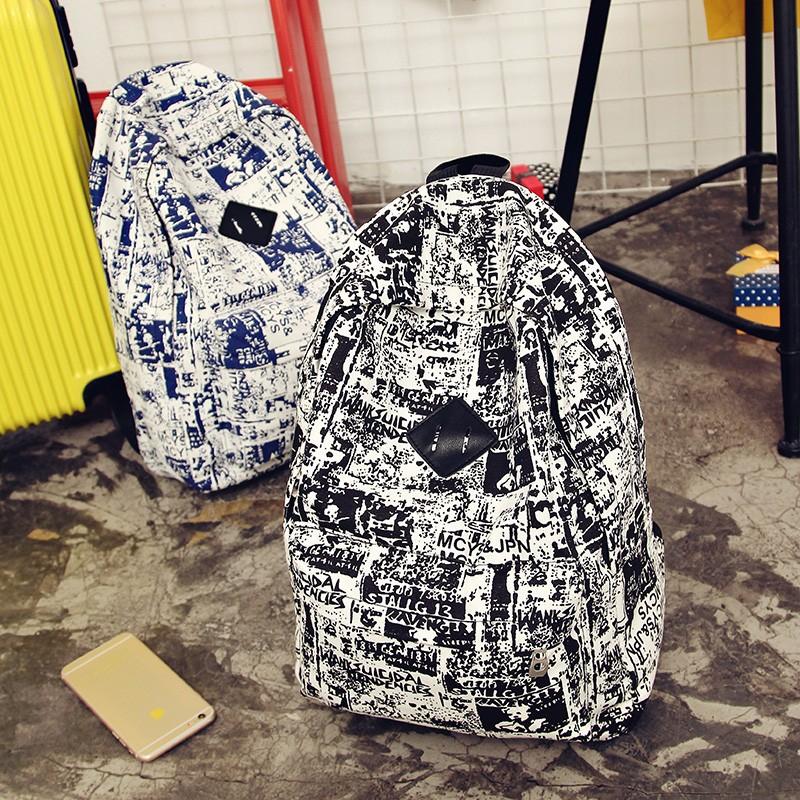 日韓男士雙肩包帆布背包 潮書包中學生學院印花 電腦包雙肩包後背包潮男男包皮革後背包帆布