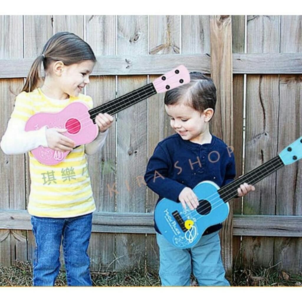 ~琪樂小舖~ H91 吉他烏克麗麗仿真吉他4 旋益智早教樂器兒童音樂玩具兩色