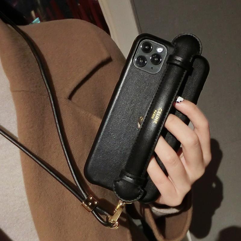 歐美 真皮 CELINE手機殼 皮革SE2 掛繩腕帶手機殼 適用於 iPhone12 11 XR X小花影視小鋪