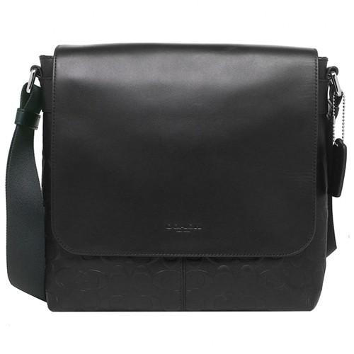 COACH黑色皮革掀蓋式浮雕LOGO斜背包