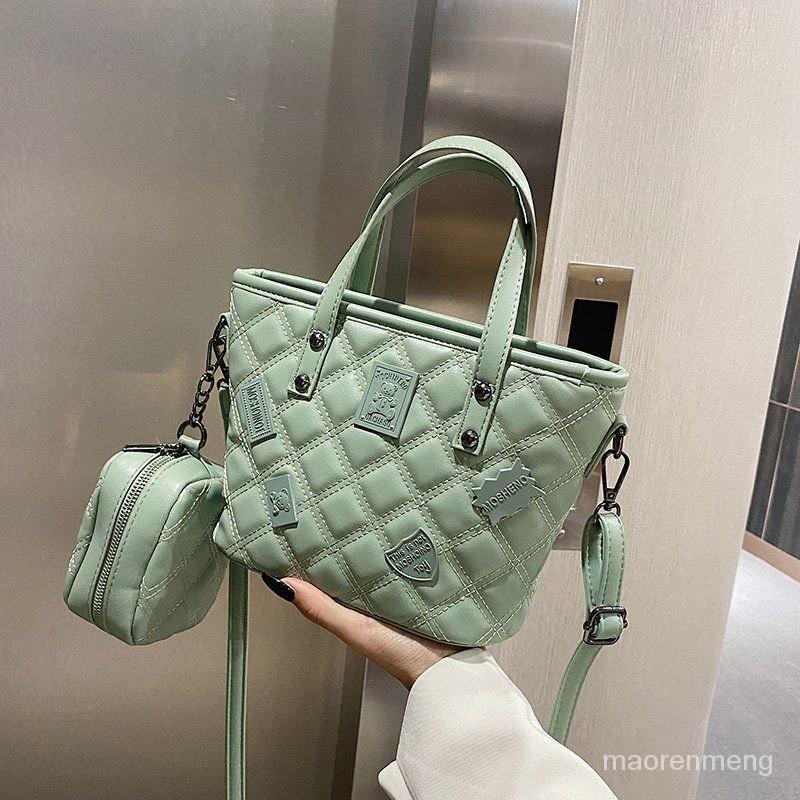 手提時尚復古女包包包單肩包水桶包流行新款斜挎潮小百搭