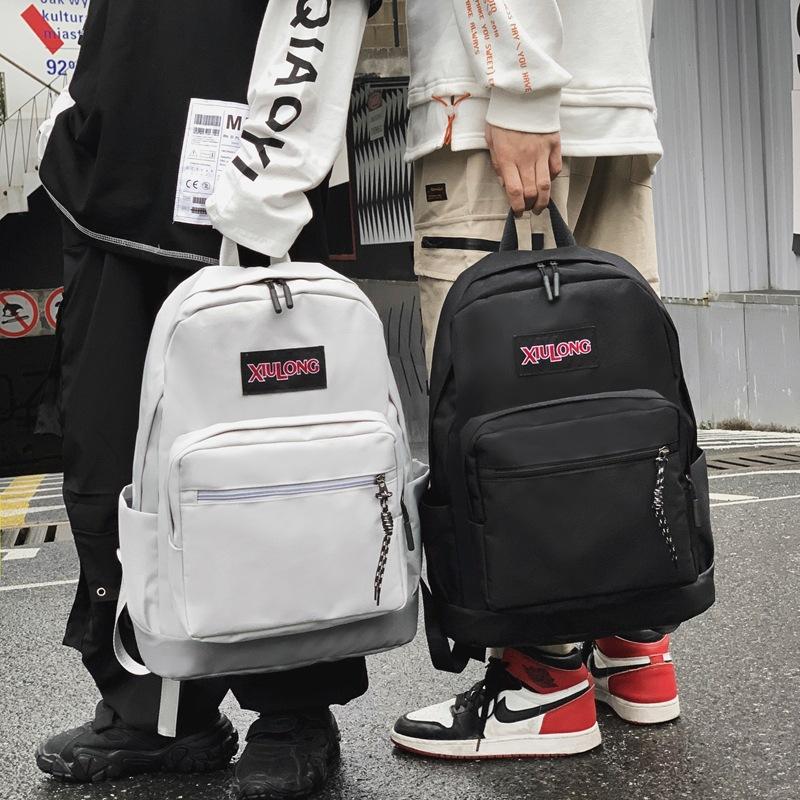 新品 新款純色防水情侶戶外運動旅行雙肩包男簡約復古港風學院風書包