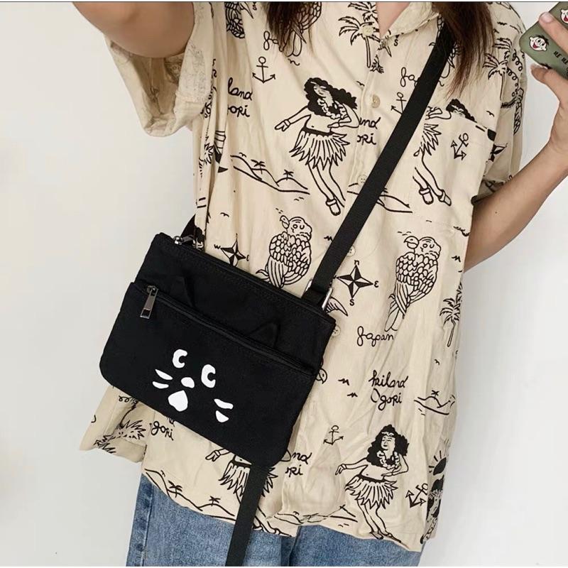 兔子雜貨 (現貨) 日牌Nya Ne-net驚訝貓帆布包單肩斜跨迷你手機包黑色拉鍊小包包