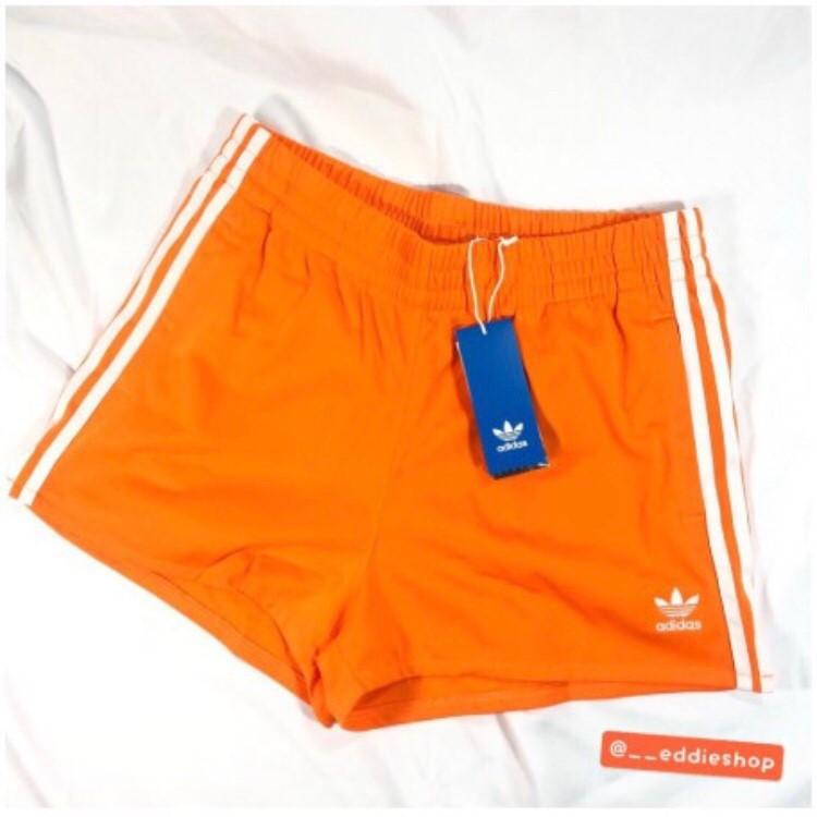 ADIDAS女褲裙 橘運動短褲DH3196/ 三線短褲BR5963/短裙 灰白三葉草AJ8434/三線緊身褲CE2441